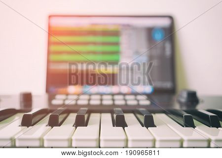Music keyboard with Computer running DAW music production program.