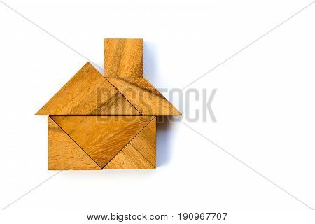 Wooden tangram puzzle in home shape on white background