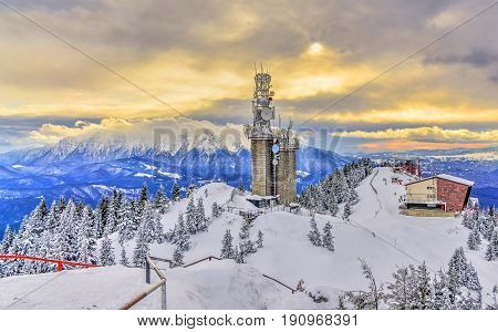 Panoramic landscape from top of Postavaru mountain Bucegi mountain in background Poiana Brasov Romania.
