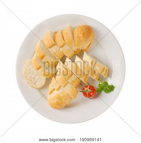 sliced french baguette on white plate