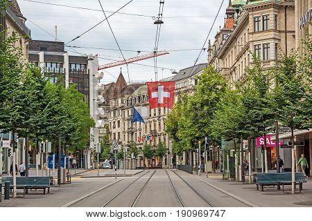 Zurich Shopping Street Bahnhofstrasse With Swiss Flag