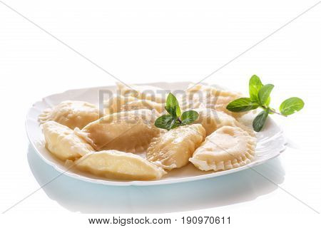 sweet boiled dumplings with cottage cheese on a white background