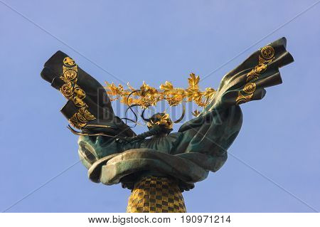 Statue architecture monument at Independence Square in Ukraine capital city Kiev isolated blue sky with clouds