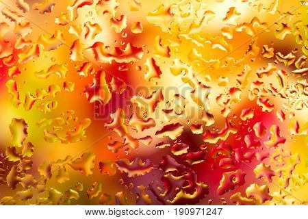 Water drops on glass with colorful background abstract rainy background