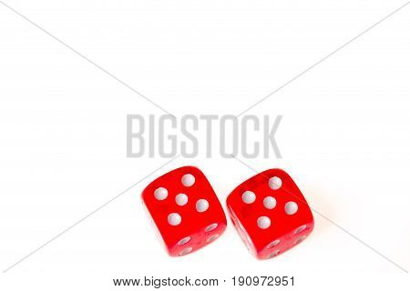 Two red dice both showing a five on the upper faceisolated against a white background