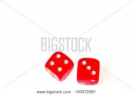 Two red dice showing a four and a three isolated against a white background