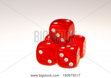 Five red dice isolated on a white background