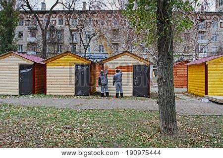 Volgograd Russia - November 18 2012: Workers paint trading houses for the Christmas fair in Volgograd