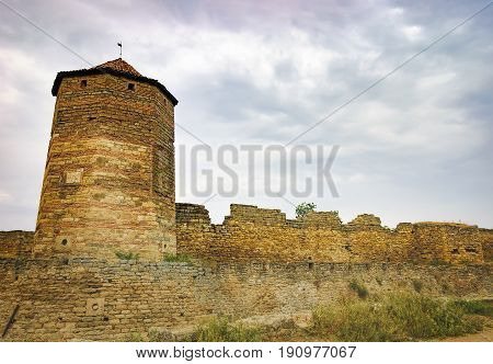 Walls arched windows and the pointed conical roof of Fortress Akkerman in the morning mist Bilhorod-Dnistrovskyi, Ukraine. This medieval fortress dates from the 13th century.