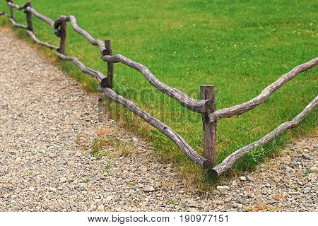 Nice wooden fence by a green grass lawn