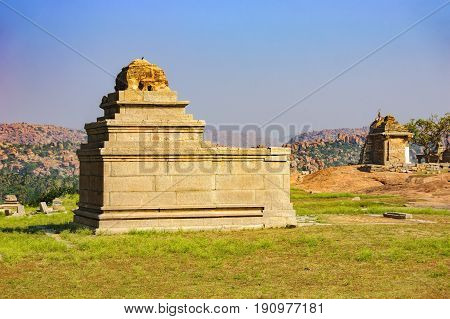 View of ancient ruins on Hemakuta hill in Hampi, Karnataka, India. Landscape with unique mountain formation with amazing stones tropical nature and temple. UNESCO World Heritage Site