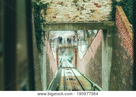PRAGUE, CZECH REPUBLIC - FEBRUARY 11, 2017: View on cable railroad from funicular cabin. The funicular railway in Prague runs from the Lesser Town up to the top of Petrin Hill.