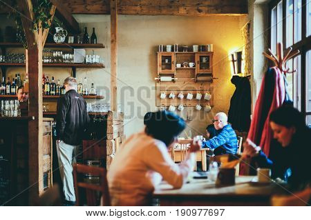 PRAGUE, CZECH REPUBLIC - FEBRUARY 12, 2017: People inside Great Monastery Restaurant located within Strahov Monastery. It is the largest non-smoking restaurant in Prague with over 620 seats.