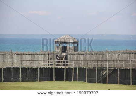 A wooden palisade of Fort Michilimackinac on the shores of Straits of Mackinac, Michigan