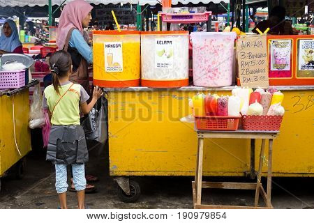 Kota Kinabalu, Sabah, Malaysia - June 10, 2017: Young Girl Buy Drink At The Night Market Stall Selli