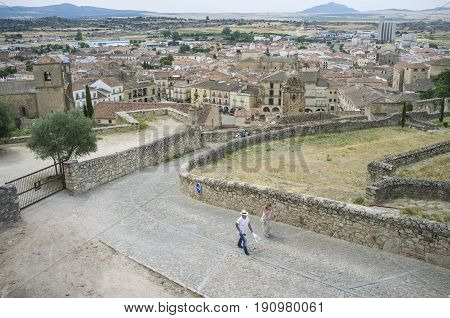 Trujillo Spain - June 4 2017: Tourists ascending from downtown to Castle of medieval Trujillo town. Caceres Extremadura Spain