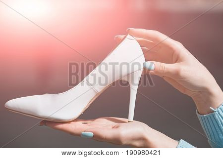 Footwear Or Shoe White Color Leather On Female Hand