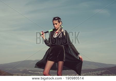 Bandit Woman In Black Sportswear Posing With Baseball Bat
