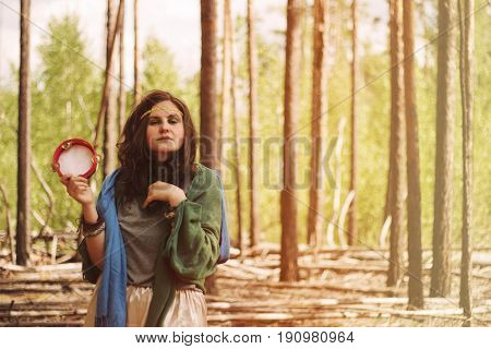 Summer Portrait Of Young Hippie Girl With A Tambourine In The Forest. Toned Photo.