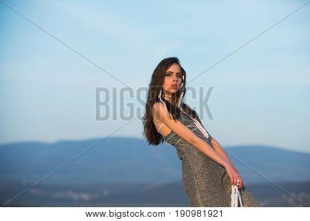 Pretty Girl Standing With White Strings In Long, Brunette Hair