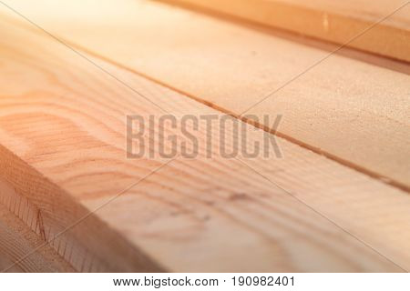 Sawn timber close-up. Boards for construction. Wooden boards