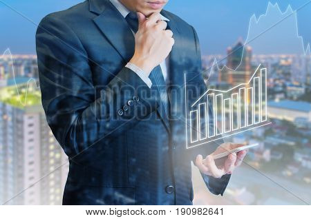 Double Exposure Of Professional Businessman Connect Internet Smart Phone Analyze Financial Graph And