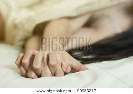 Close Up Hands Of A Couple Make Love Hot Sex On A Bed