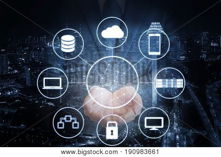 Double exposure of professional businessman hold all devices technology connecting with network and city of business background in blue tone