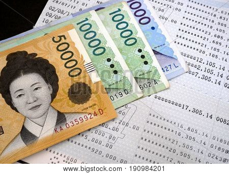 Korean won banknote on bank statement. Finance and banking concept