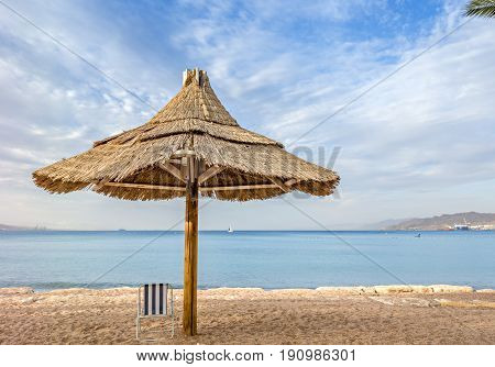 Summer morning at sandy beach of Eilat - famous resort city in Israel