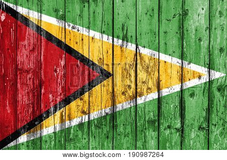 Flag of Guyana painted on wooden frame