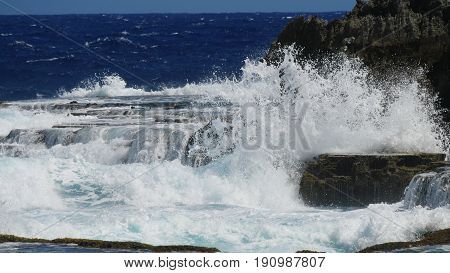 Angry waves at Marine Beach, Saipan  Angry waves slapping against sharp cliff rocky formations is an awesome view to watch