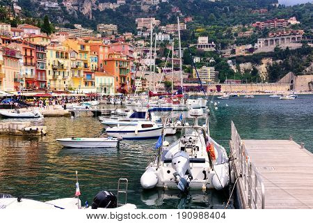 Nice France - June 8 2016: The popular destination of Villefranche-sur-Mer near Nice on the French Riviera. The bay is naturally deep therefore popular with large yachts and ships.