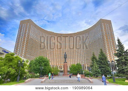 MOSCOW, JUN, 8, 2017: View of famous international Hotel Cosmos curved building, USSR Russia architecture and famous french president Charles De Gaulle monument sculpture. World famous hotels