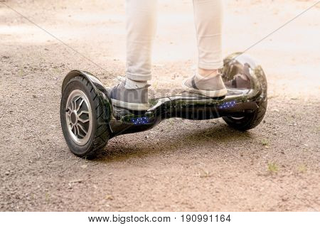 Moscow, Russia, June 7 2017: Girl feet on the hover board.This modern gadget is also known as hoverboard, gyroscooter, mini scooter