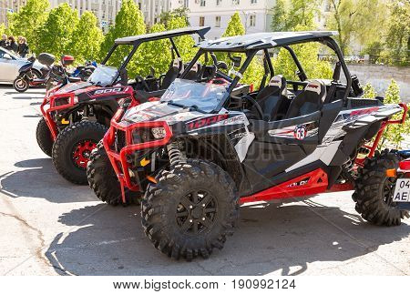Samara Russia - May 13 2017: Red atv quad bikes parked at the city street in summer day
