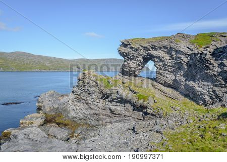 Cliff formation Kirkeporten with view to the North Cape Horn, Finnmark, Norway