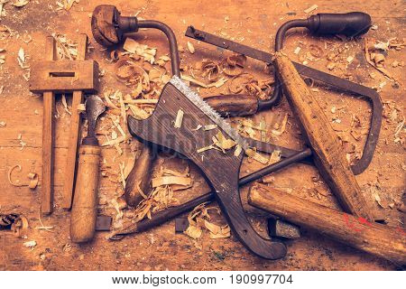 Old joiner's tools on a wooden table. Workshop