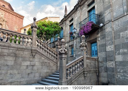 Beautiful ancient stairs at old Spanish village (Poble espanyol)