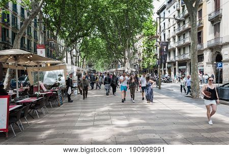 BARCELONA, SPAIN - MAY 2017: People at famous La Rambla street in center of Barcelona town.