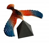 Tabletop toy balancing eagle and the pyramid isolated on white. poster