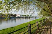 Riverbank and Bridge over the river in Piestany poster