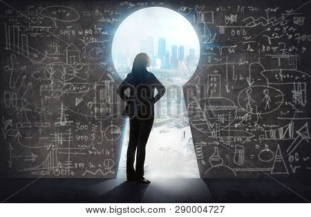 Young Woman Looking At The City Of London In The Keyhole. Intelligence Lead To The Success. Business
