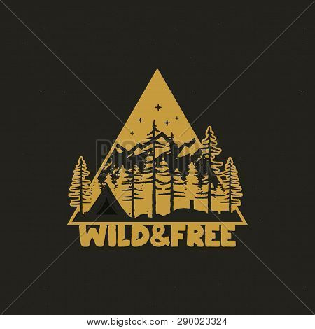 Hand Drawn Travel Badge With Camp Tent, Mountains, Pine Trees Forest And Quote - Wild And Free. Old