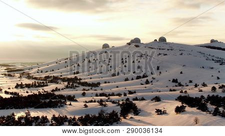 Aerial View Of The Astrophysical Observatory In Wintertime In Snowy Forest, Crimea. Shot. Beautiful
