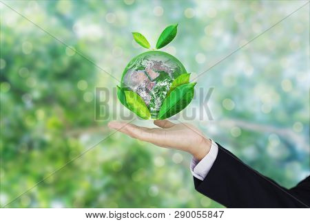 Earth Day, Protect The World With Environment And Eco-friendly Business. Businessman Hand Holding Gl