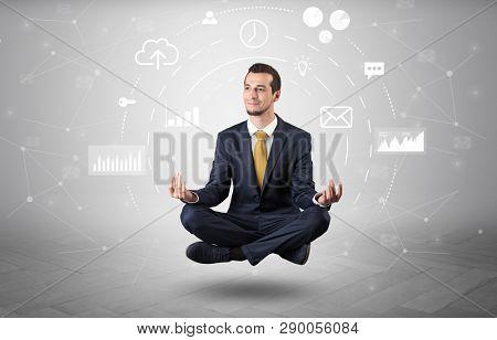 Elegant calm businessman levitates in yoga position with data circulation concept poster