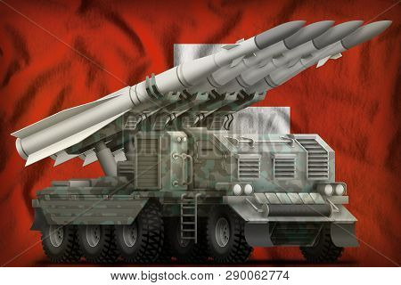 Tactical Short Range Ballistic Missile With Arctic Camouflage On The Switzerland Flag Background. 3d
