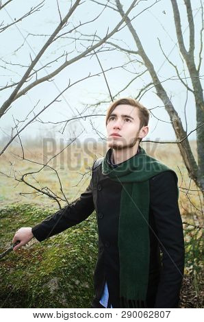 Young Guy Walks In The Spring Garden