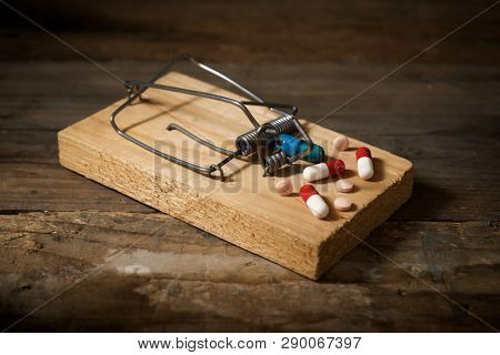 Medicines in a wooden mouse trap.